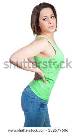 Woman holding hands in the back because of back pain - stock photo