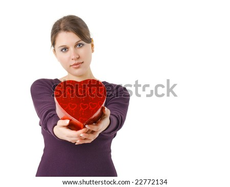 woman holding heart shaped gift box for Valentines day - stock photo