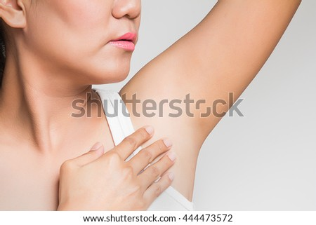 woman holding her arms up and showing underarms