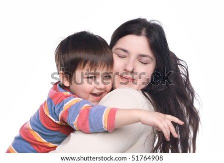Woman holding her little child on hands - stock photo