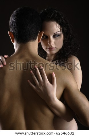 Woman holding her man with his back towards the camera - stock photo