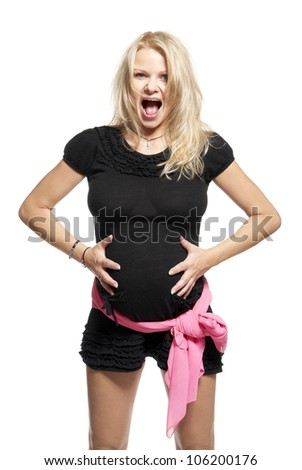 Woman holding her pregnant belly. 9 month.  Studio photo of pregnant woman isolated on white. - stock photo
