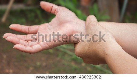 woman holding her wrist, pain concept, Office Syndrome - stock photo