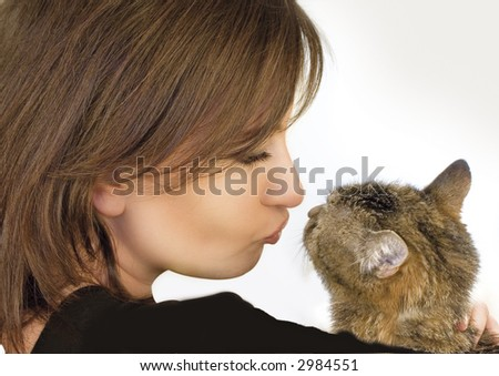 woman holding, hugging, kissing her little cat - stock photo