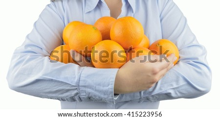 woman holding in her arms citric fruits like oranges with white background - stock photo