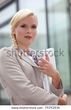 Woman holding laptop - stock photo