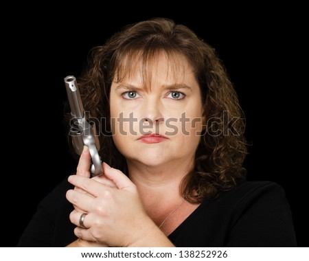 Woman holding loaded gun - stock photo