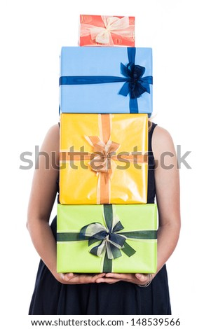 Woman holding many colorful presents, isolated on white background. - stock photo