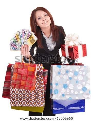 Woman holding money, gift box and shopping bag. Isolated.
