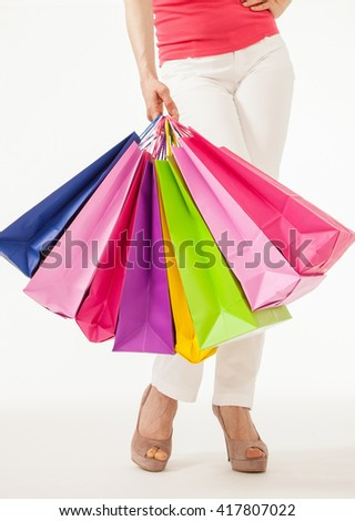 Woman holding  multicolored shopping bags, copyspace - stock photo