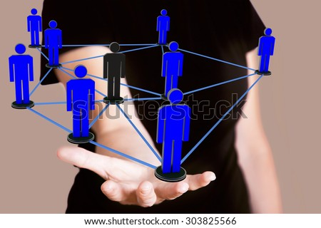 Woman holding network with human figures