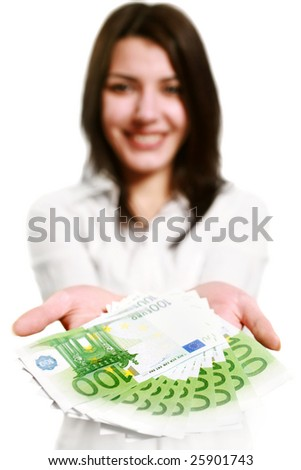 Woman holding out money. Focus on money (woman's face out of focus). - stock photo