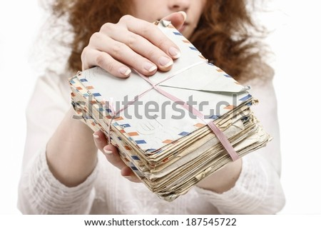 Woman holding package of vintage letters - stock photo