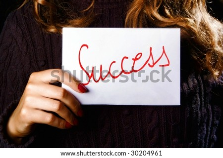 Woman holding paper with the success word - stock photo