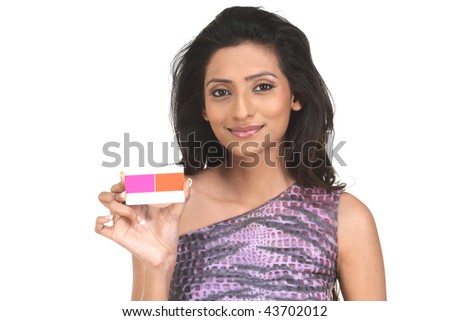 Woman holding pink credit card