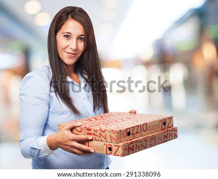 woman holding pizza boxes - stock photo