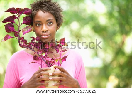 Woman holding plant - stock photo