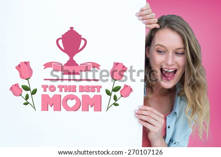 Woman holding poster against pink vignette - stock photo