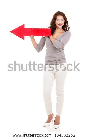 woman holding red arrow pointing to left - stock photo