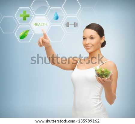 woman holding salad and working with menu on virtual screen - stock photo