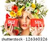 Woman holding sale banner and flower. Isolated. - stock photo