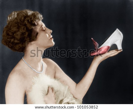 Woman holding shoe