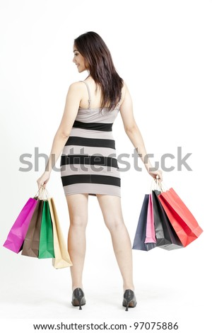 Woman holding shopping bags against a white background