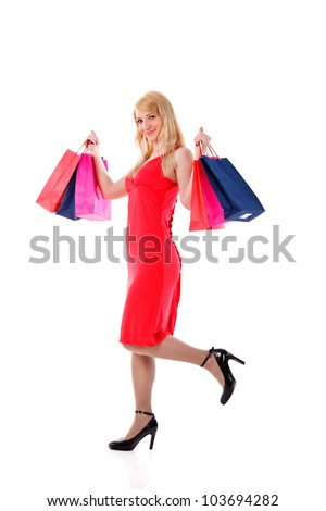 woman holding shopping bags against white background