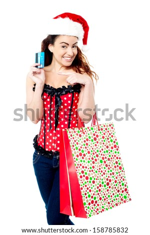 Woman holding shopping bags and credit card - stock photo