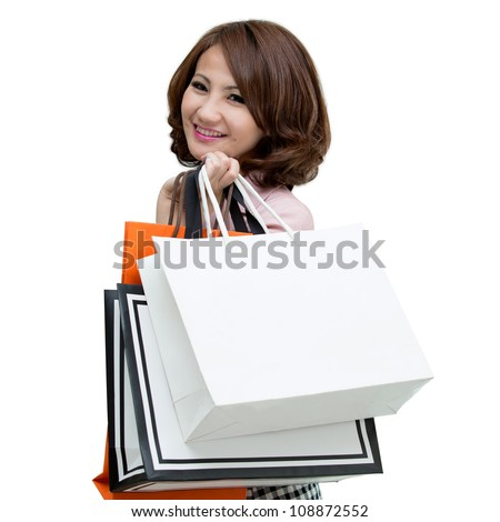 woman holding shopping bags isolated on white background - stock photo