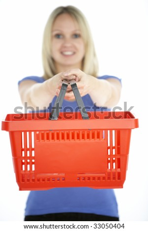 Woman Holding Shopping Basket - stock photo