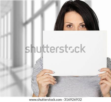 Woman Holding Sign. - stock photo