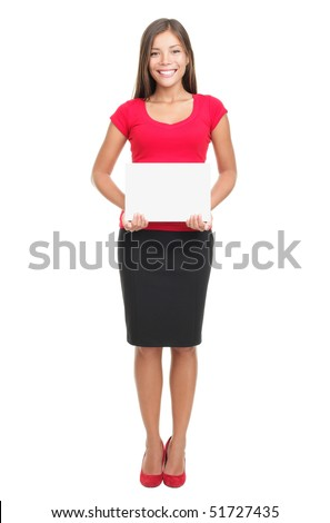Woman holding sign isolated. Full body image of young beautiful multiracial woman holding blank sign. Isolated on white background. - stock photo