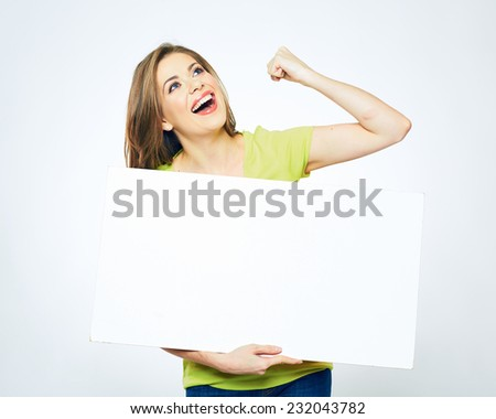 woman holding sign white card looking up. isolated studio portrait of beautiful girl with advertising board. - stock photo