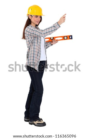 Woman holding spirit-level