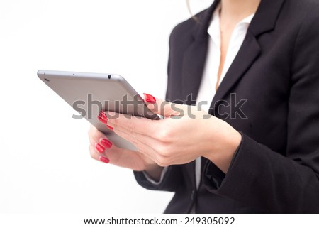 Woman holding tablet computer in hands on white background