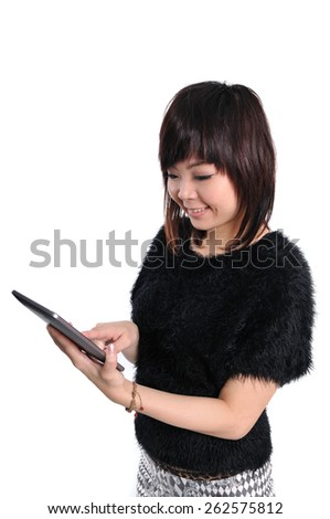 Woman holding tablet computer isolated on white background. working on touching screen. Casual smiling asian woman. - stock photo