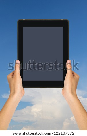Woman holding  tablet : sky background - stock photo