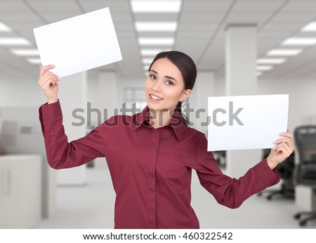 Woman holding the paper sheets.