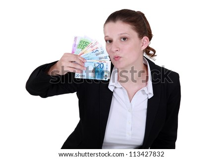 Woman holding tickets - stock photo