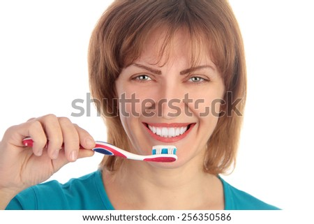 woman holding toothbrush