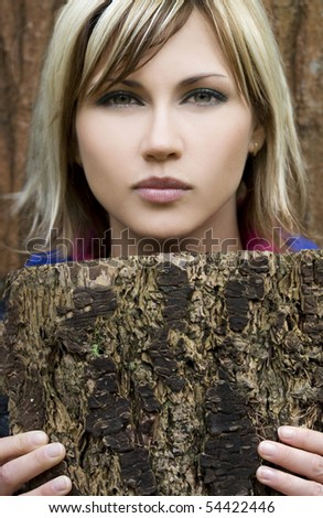 Woman holding tree bark - stock photo