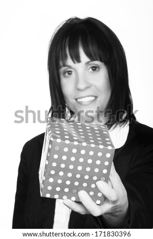 woman holding up a small gift - stock photo