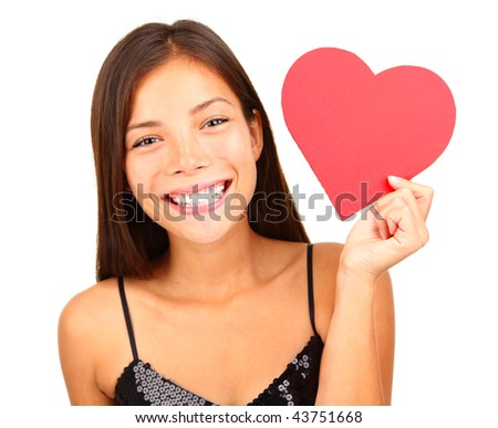 Woman holding Valentines Day heart sign with copy space. Beautiful mixed race asian / caucasian model isolated on white background. - stock photo