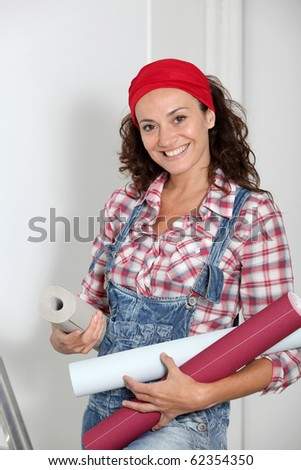 Woman holding wallpaper rolls for the house