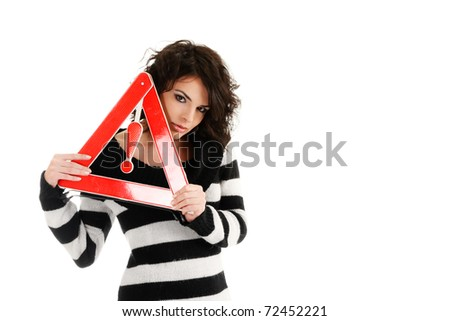 Woman holding warning road sign isolated on white background - stock photo