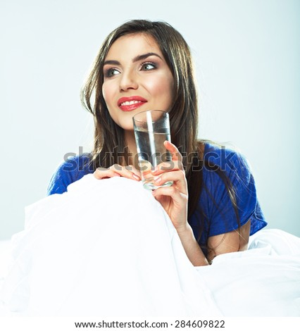 Woman holding water glass. Smiling model. - stock photo