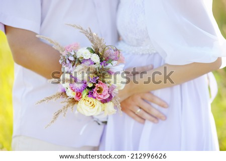 Woman holding wedding flowers bouquet  - stock photo