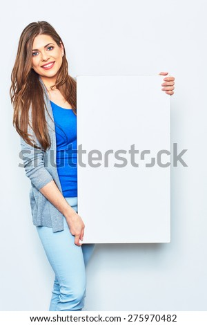 Woman holding white blank signboard. Smiling female model against white studio background. - stock photo
