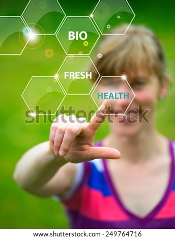 woman holding working with menu on virtual screen and touching the button bio - stock photo